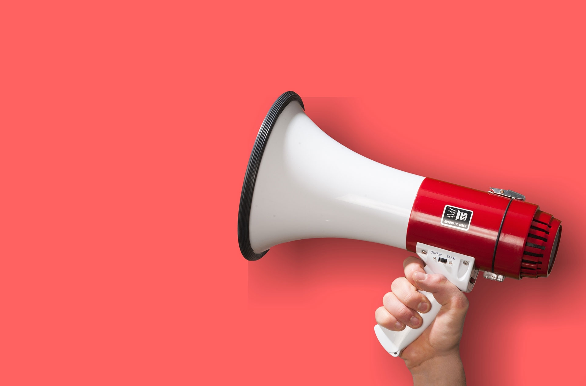 attention, announcement, hand holding megaphone on red background